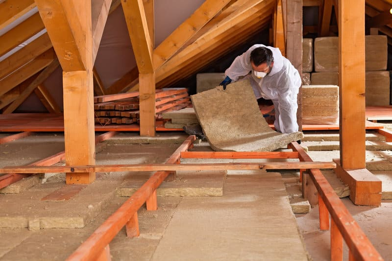 Insulation Replacement: Man putting thermal insulation