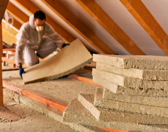 Moisture Barrier: Man laying thermal insulation